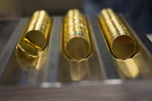 One ounce 24 karat gold proof blanks are seen at the United States West Point Mint facility in West Point, New York